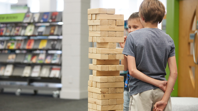 Two boys playing Jenga