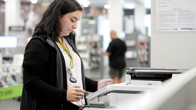 Woman using photocopier